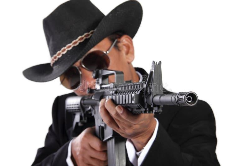 Tendenza professionale dell'assassino, isolata su bianco fotografia stock