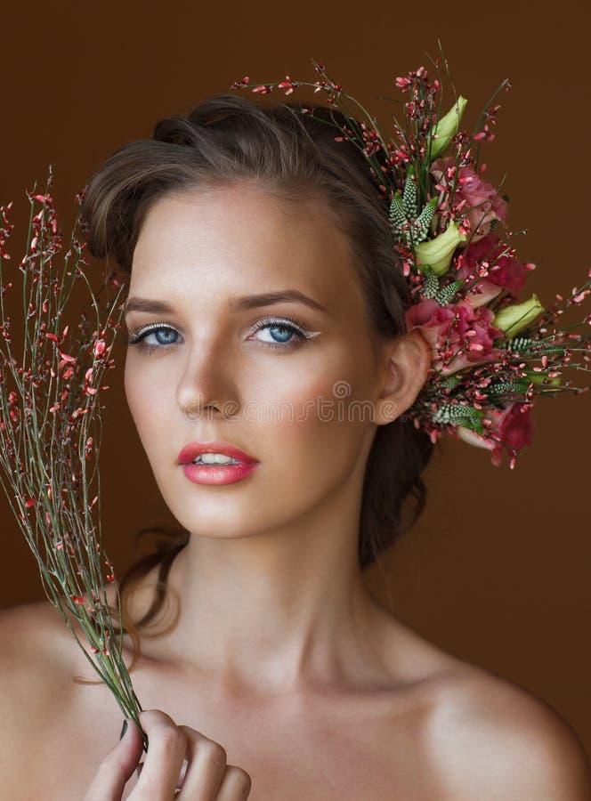 Tender beauty portrait of bride with flowers wreath in
