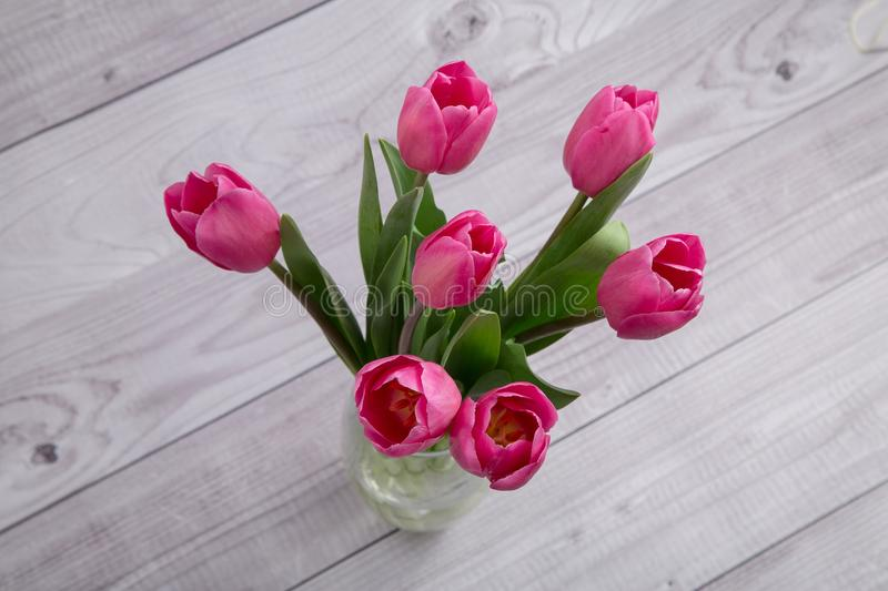 Tender bouquet of spring pink tulips stock photos