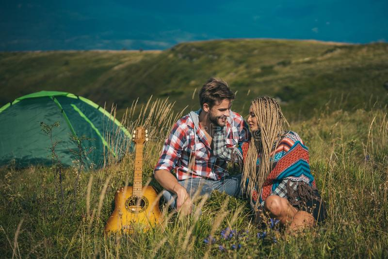 Tender couple in love. Romantic trip, camping in mountains. Couple of dreamers hugging and embrace. Lovers hug. Sensual royalty free stock photos