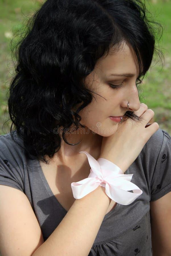 Tender dark-haired girl royalty free stock photos