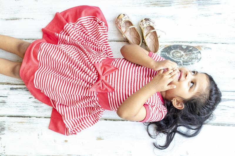 Tender girl lying next to her golden slippers stock photos
