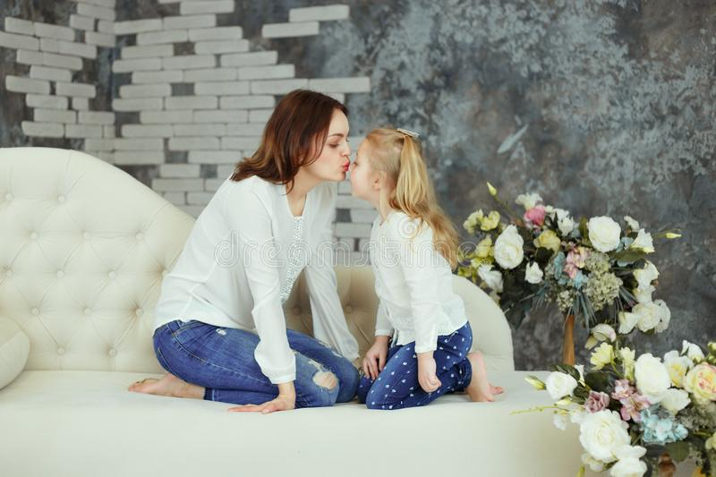 Tender kiss mother and daughter stock photos