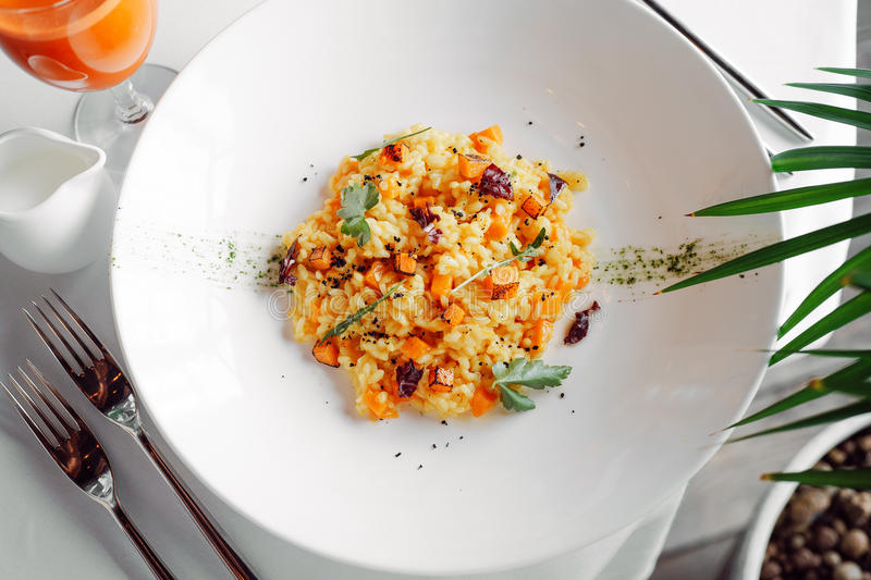 Tender risotto with pumpkin royalty free stock photography