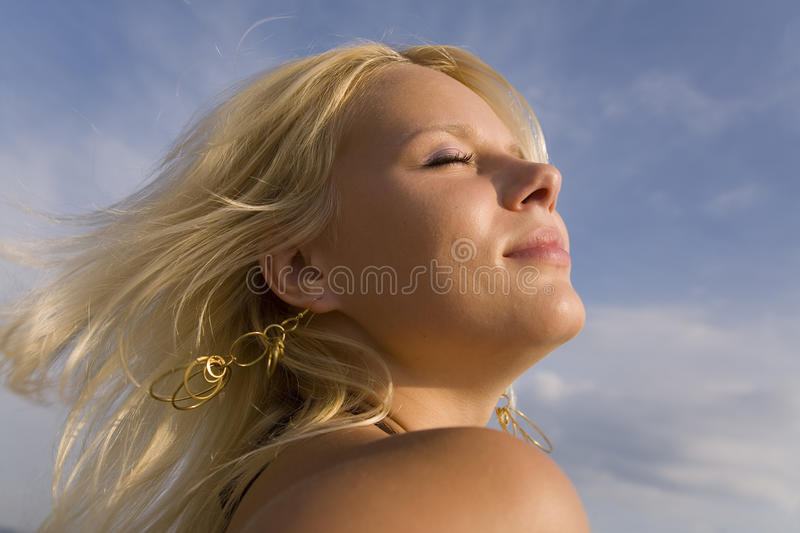 The tender sun. Portrait of the girl blindly stock image