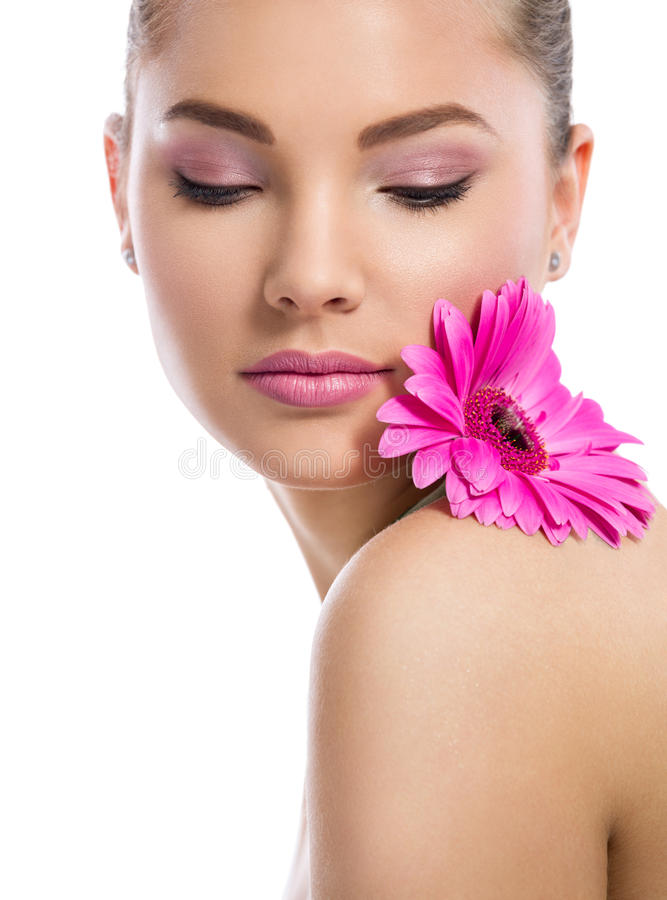 Tender young woman with perfect skin. And flower on shoulder stock photo