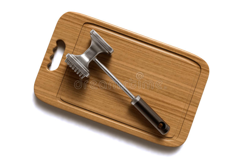 Tenderizer da carne na placa de madeira No branco foto de stock