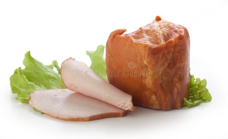 Tenderlion de porc avec de la laitue images stock