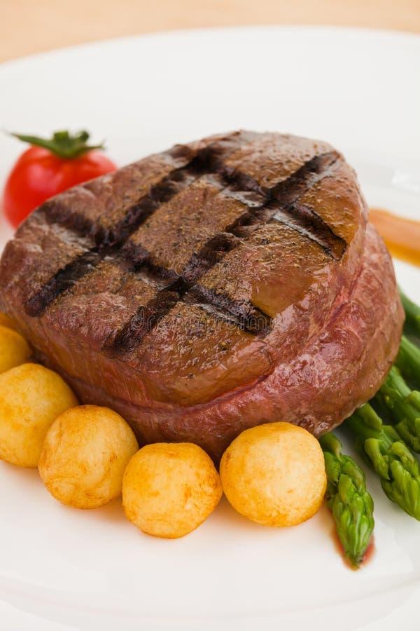 Tenderloin steak in a white plate royalty free stock photos
