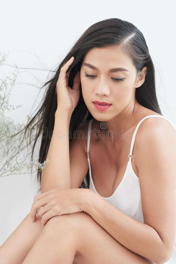 Tenderness. Attractive tender Vietnamese young woman with long hair royalty free stock image