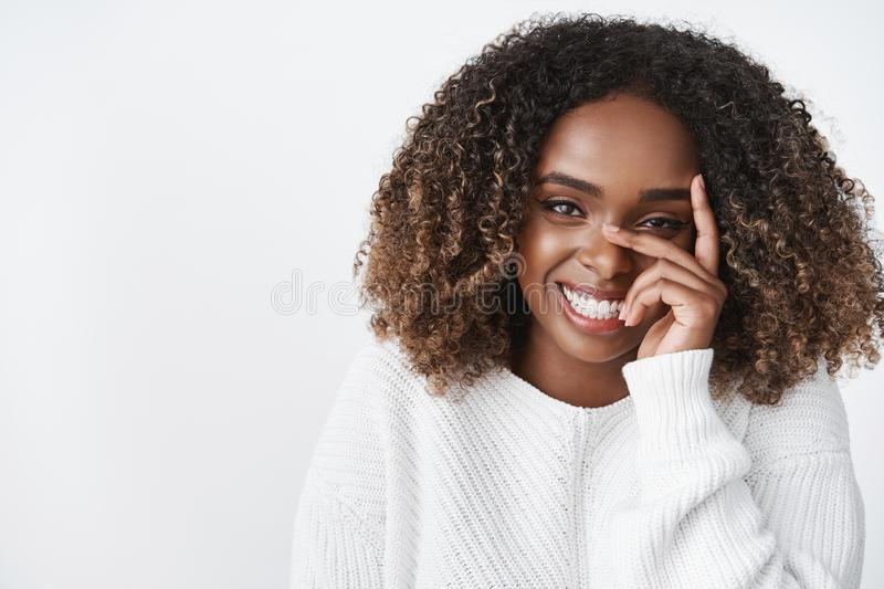 Tenderness, beauty and pure emotions concept. Portrait of sensual tender and cute african american girlfriend in sweater royalty free stock image