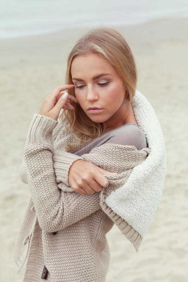 Tenderness. Sensual woman on the autumn beach royalty free stock photography