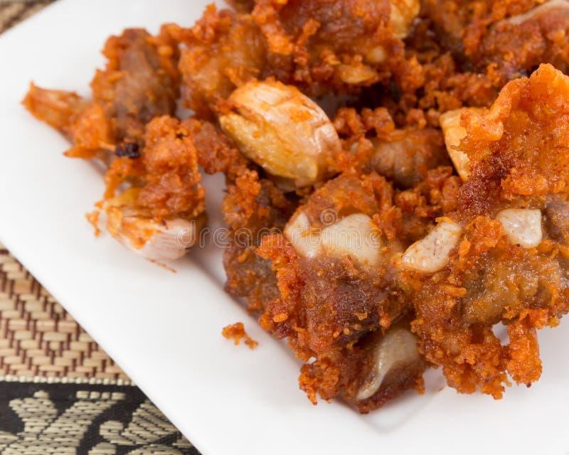 Tendones fritos del cerdo con gusto delicioso foto de archivo libre de regalías
