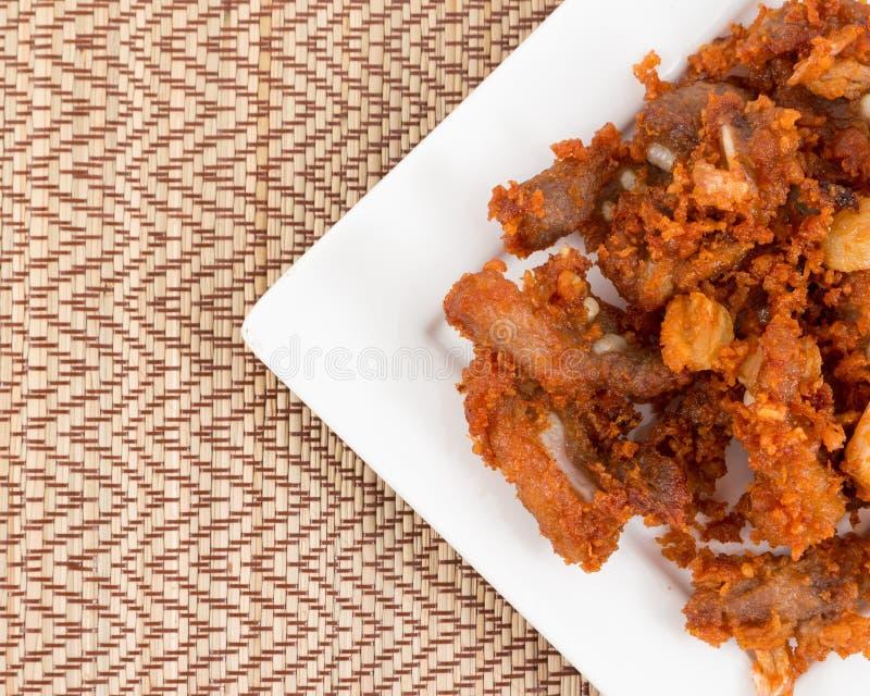 Tendones fritos del cerdo con gusto delicioso foto de archivo
