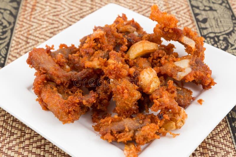 Tendones fritos del cerdo con gusto delicioso imagen de archivo libre de regalías