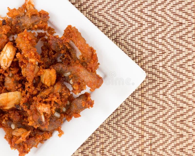 Tendones fritos del cerdo con gusto delicioso fotos de archivo