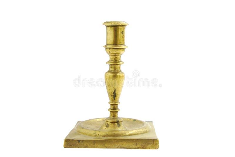 Tenedor de bronce viejo de la palmatoria en el fondo blanco fotografía de archivo libre de regalías