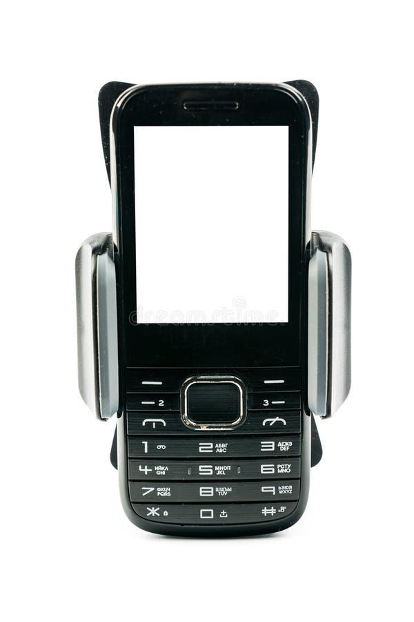 Tenedor universal del teléfono para la moto y la bici del coche con el teléfono simple instalado de la pantalla en blanco Aislado imagen de archivo libre de regalías