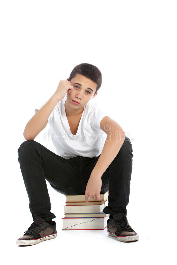 Teneergeslagen teenaged jongen met zijn handboeken royalty-vrije stock foto