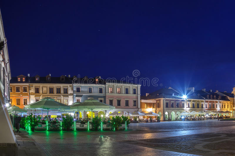 Tenement houses at night. Tenement houses of the old Market Square in Zamosc, Poland stock images