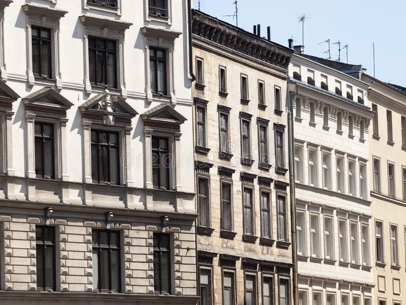 Tenement houses / town house windows street urban style background. Cracow, Poland and polish architecture concept. View during daytime, building facade stock photo