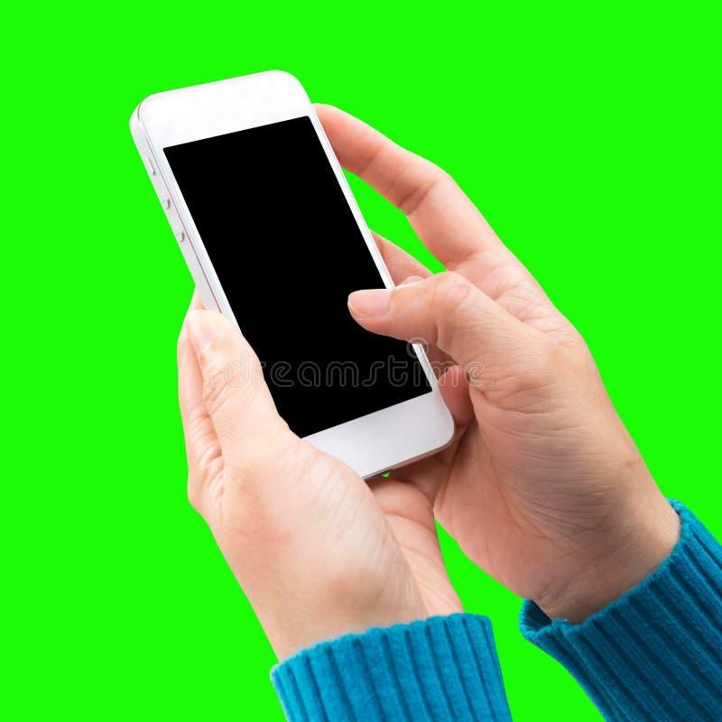 Tenencia de la mano de la mujer y móvil con, teléfono celular, teléfono elegante con la pantalla imágenes de archivo libres de regalías