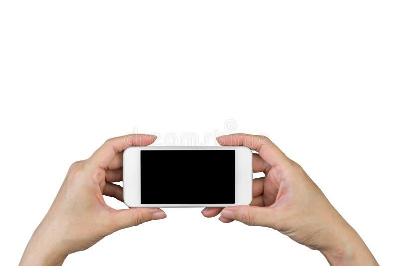 Tenencia de la mano de la mujer y móvil con, teléfono celular, teléfono elegante con la pantalla aislada foto de archivo libre de regalías