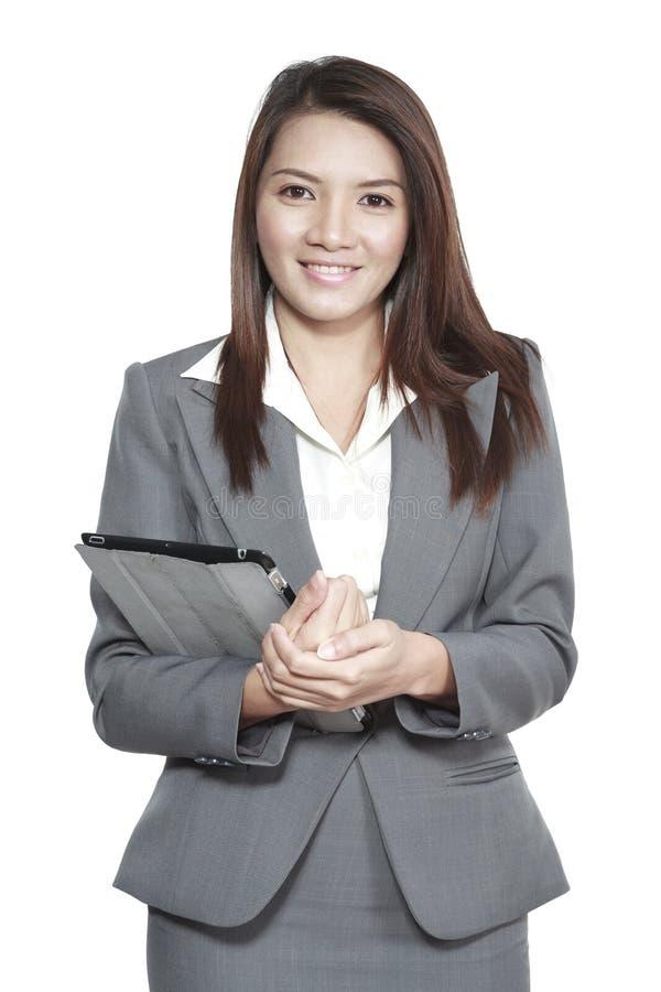 Tenencia derecha atractiva del gesto asiático de la oficina de la mujer de negocios fotografía de archivo
