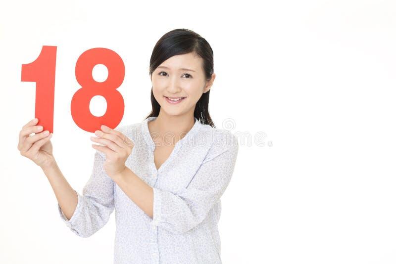 Tenencia número dieciocho de la mujer imágenes de archivo libres de regalías