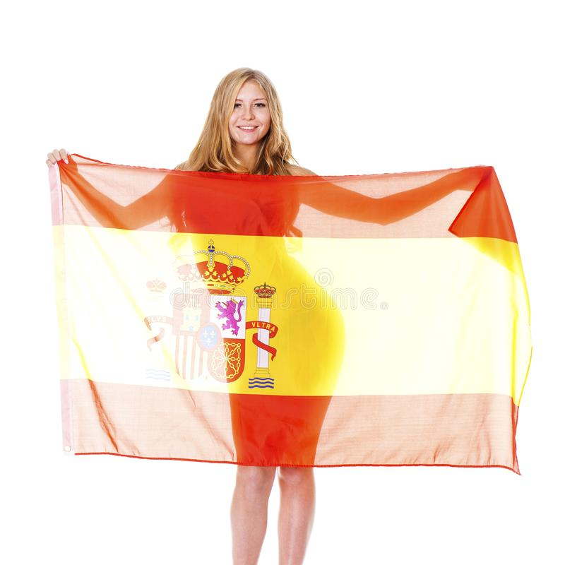 Tenencia rubia feliz joven una bandera española aislada en el fondo blanco foto de archivo libre de regalías
