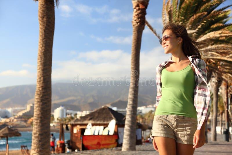 Tenerife. Beach boardwalk woman enjoying the sun in Playa de las Americas, Tenerife south, Canary Islands, Spain stock photography