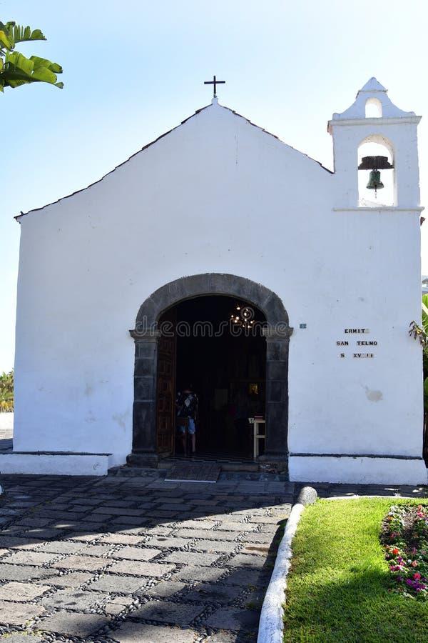 Spain, Canary Islands, Tenerife, Puerto de la Cruz. Tenerife, Canary Islands, Spain - April 03, 2018: Unidentified people at historic chapel San Telmo in Puerto stock images