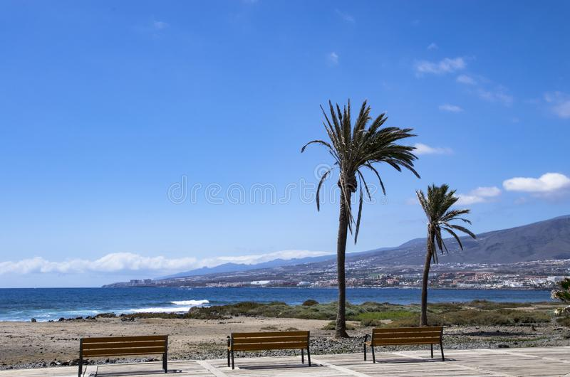 Tenerife coast landscape with empty benches royalty free stock images