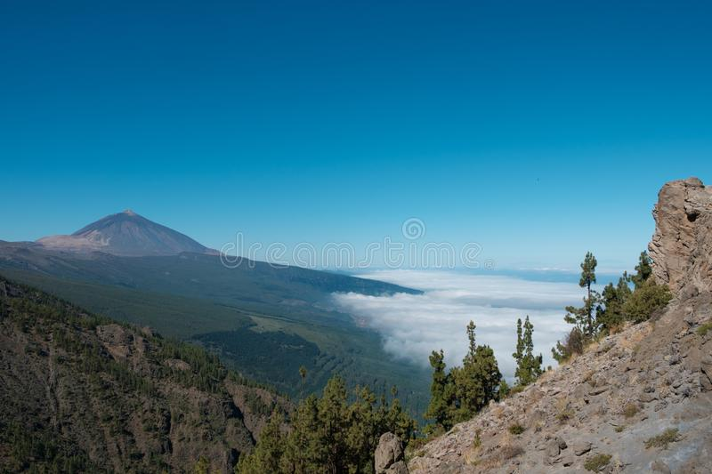Tenerife mountain landscape with view on Pico del Teide summit a. Bove clouds royalty free stock photography