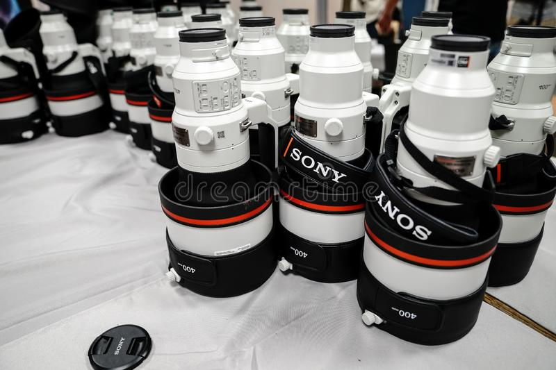 Sony 400 mm telephoto lenses for Alpha 9 series are stacked during a conference for. Tenerife, Spain - March 21, 2019: Sony 400 mm telephoto lenses for Alpha 9 stock image