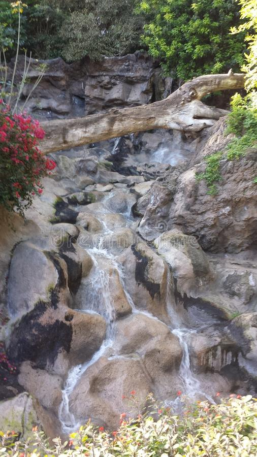 Tenerife Waterfall with greenery and rock formations. A beautiful photograph of a waterfall in Tenerife. The stunning rock formations make this photo really come royalty free stock photos