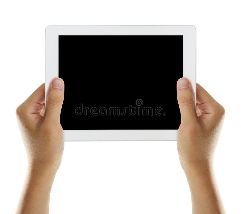 Tenez le comprimé avec l'écran noir 2 image libre de droits
