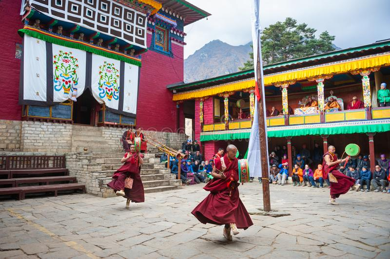 The monks perform religious buddhistic dance during the Mani Rimdu festival in Tengboche Monastery. Tengboche, Nepal - October, 24, 2018: The monks perform stock photos