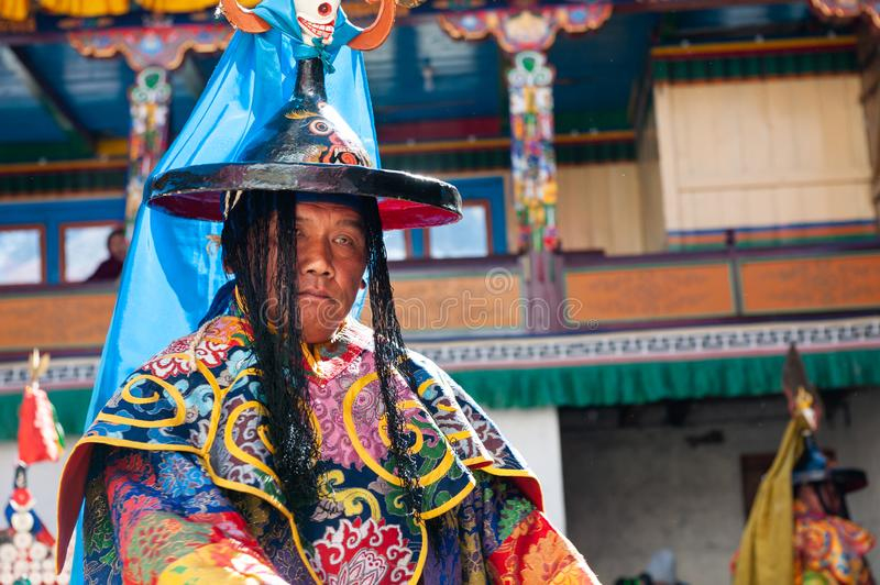 The monks perform religious buddhistic dance during the Mani Rimdu festival in Tengboche Monastery. Tengboche, Nepal - October, 26, 2018: The monks perform stock photo