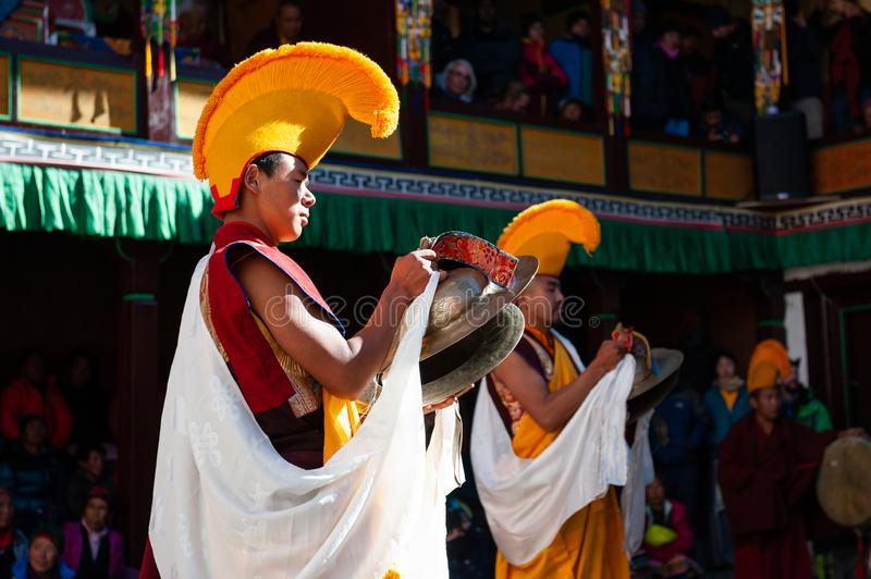 The monks perform religious buddhistic dance during the Mani Rimdu festival in Tengboche Monastery. Tengboche, Nepal - October, 26, 2018: The monks perform stock images