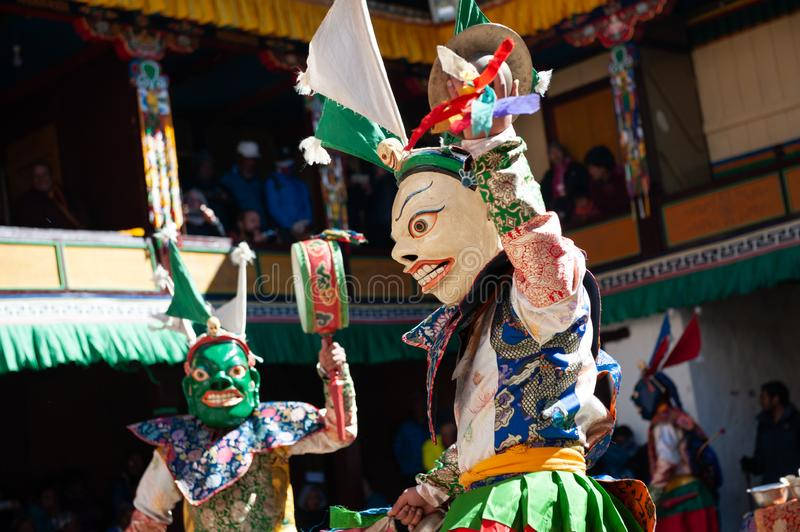 The monks perform religious masked buddhistic dance during the Mani Rimdu festival in Tengboche Monastery royalty free stock photography