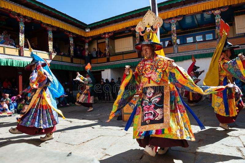 The monks perform religious masked buddhistic dance during the Mani Rimdu festival in Tengboche Monastery royalty free stock photo