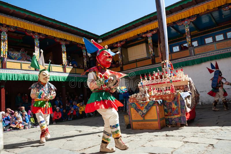 The monks perform religious masked buddhistic dance during the Mani Rimdu festival in Tengboche Monastery stock photography