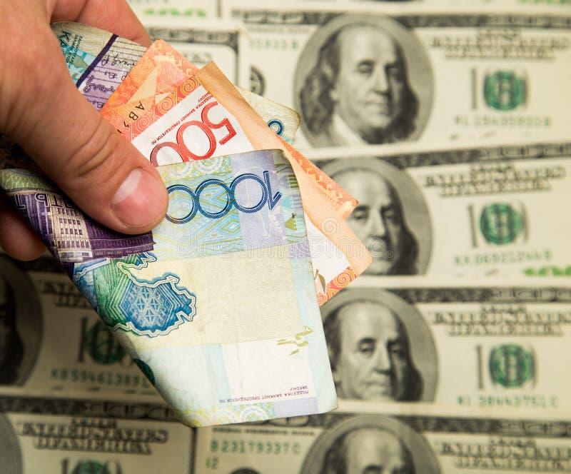 Tenge kazakh et U S Dollars photographie stock libre de droits