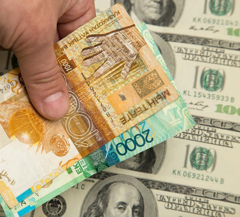 Tenge kazakh et U S Dollars image libre de droits