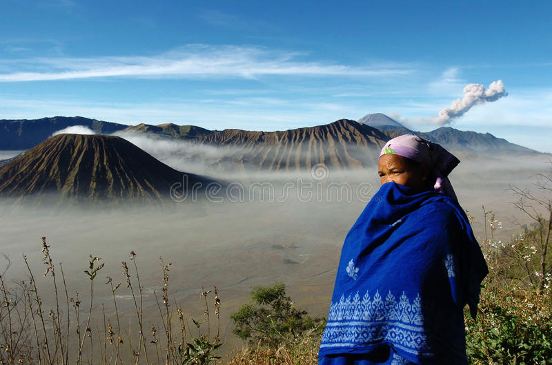 Tengger. EAST JAVA, INDONESIA, AUGUST 2007 - Tengger tribal women in the crater of Mount Bromo, East Java, Indonesia. Mount Bromo is a cluster of volcanoes in stock photo