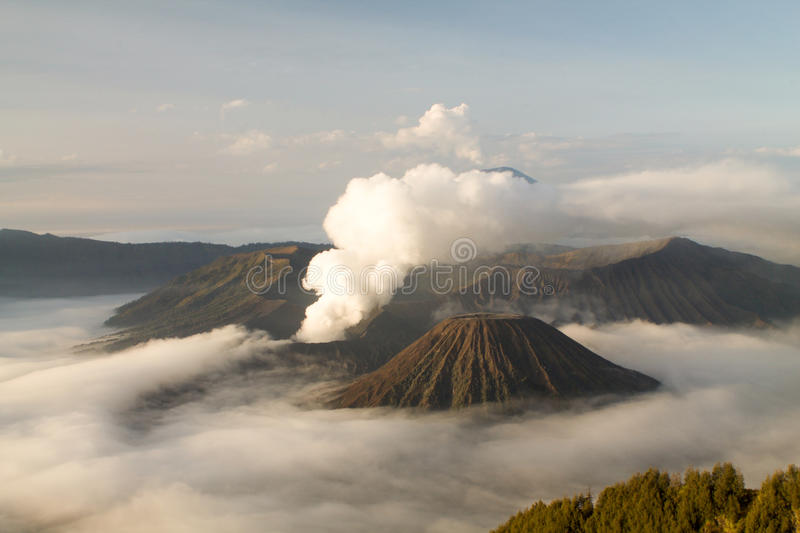 Tengger caldera in the clouds, bromo volcano. Active royalty free stock photography