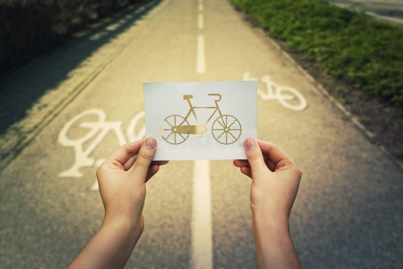 Tenir l'icône de bicyclette image stock
