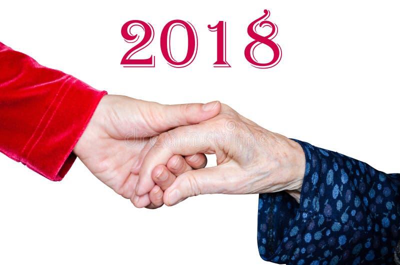 Tenir la main supérieure du ` s de femme, concept 2018 d'aide images libres de droits