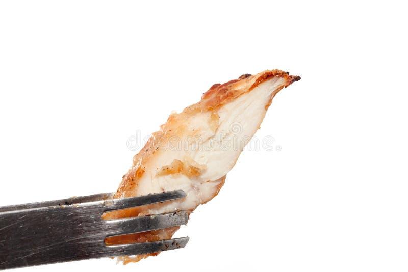 Tenir le sein de poulet rôti photos libres de droits